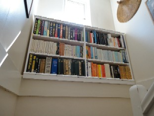 Painted Bookcase On The Stairs